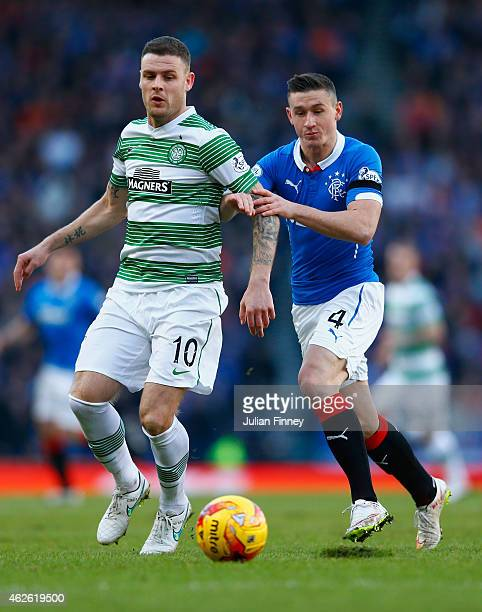 Anthony Stokes of Celtic and Fraser Aird of Rangers compete for the ball during the Scottish League Cup SemiFinal between Celtic and Rangers at...