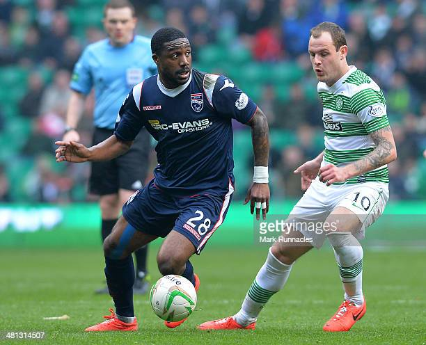 Anthony Stokes of Celtic chases Yann Songo'o of Ross County during the Scottish Premier League match between Celtic and Ross County at Celtic Park...
