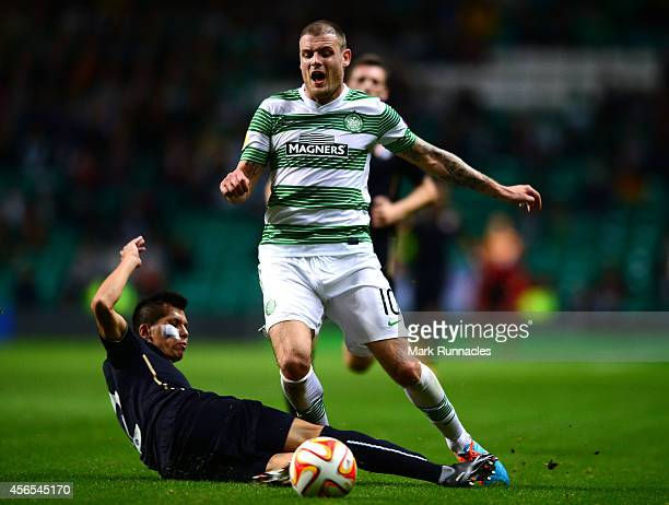 Anthony Stokes of Celtic is challenged by El Arabi Hilal Soudani of Dinamo Zagreb challenge during the UEFA Europa League group D match between...