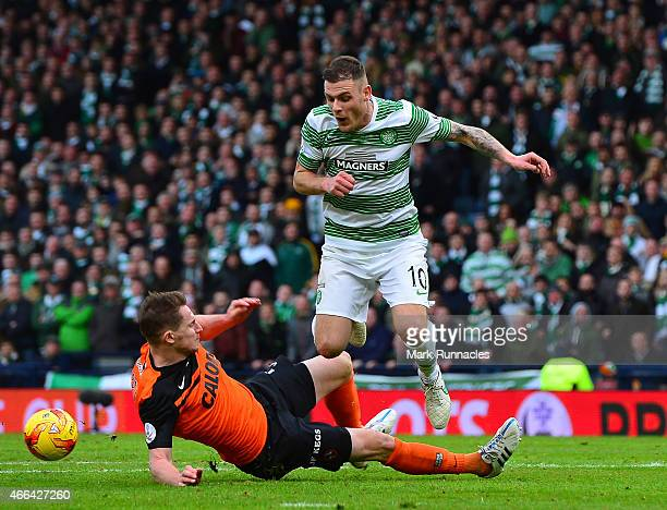Anthony Stokes of Celtic is tackled by Paul Dixon of Dundee United during the Scottish League Cup Final between Dundee United and Celtic at Hamden...