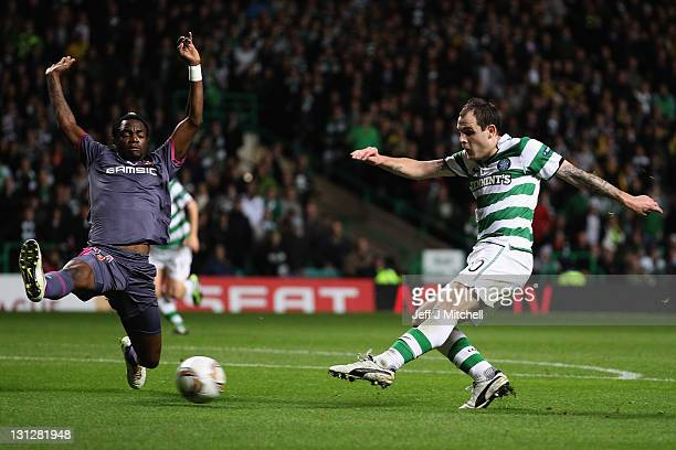Anthony Stokes of Celtic puts the ball past Georges Mandjeck of Stade Rennais to score his second goal during the UEFA Europa League group I match...