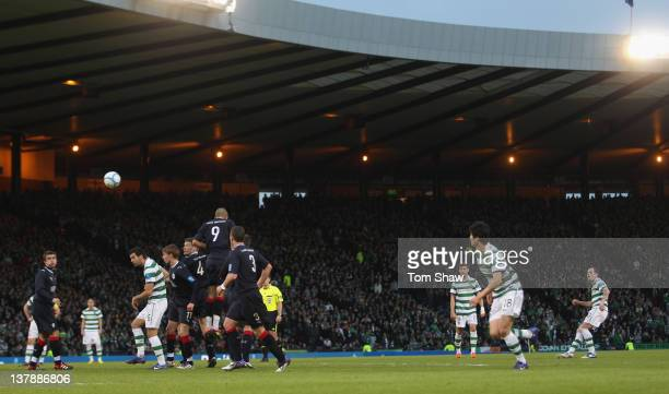 Anthony Stokes of Celtic scores the second goal during the Scottish Communities Cup Semi Final match between Falkirk and Celtic at Hampden Park on...