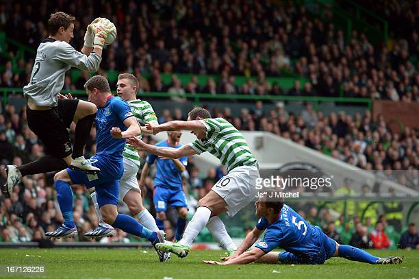 Anthony Stokes of Celtic tackles Garry Warren and Antonio Reguero of Inverness Caledonian Thistle during the Clydesdale Bank Scottish Premier League...