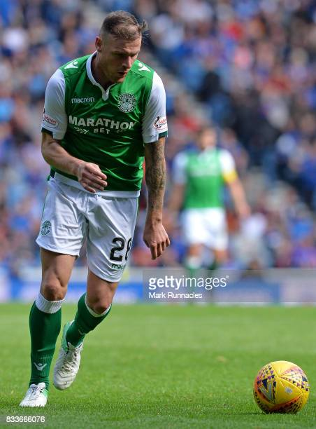 Anthony Stokes of Hibernian in action during the Ladbrokes Scottish Premiership match between Rangers and Hibernian at Ibrox Stadium on August 12...