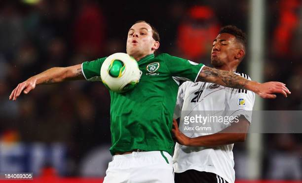 Anthony Stokes of Ireland is challenged by Jerome Boateng of Germany during the FIFA 2014 World Cup Group C qualifiying match between Germany and...