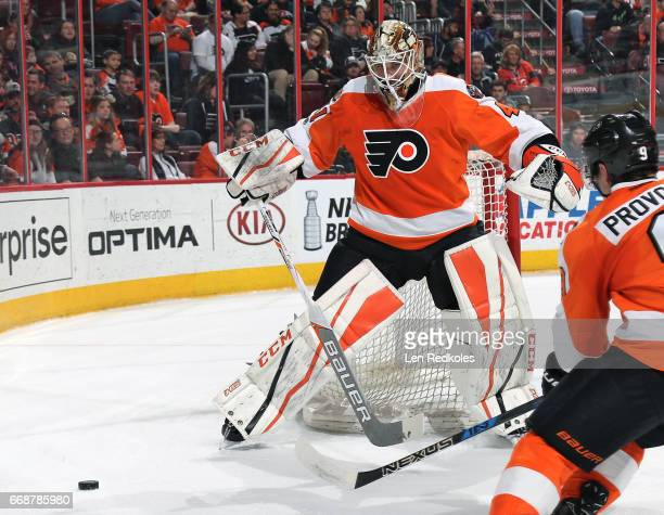 Anthony Stolarz and Ivan Provorov of the Philadelphia Flyers clears the puck from the net against the Carolina Hurricanes on April 9 2017 at the...