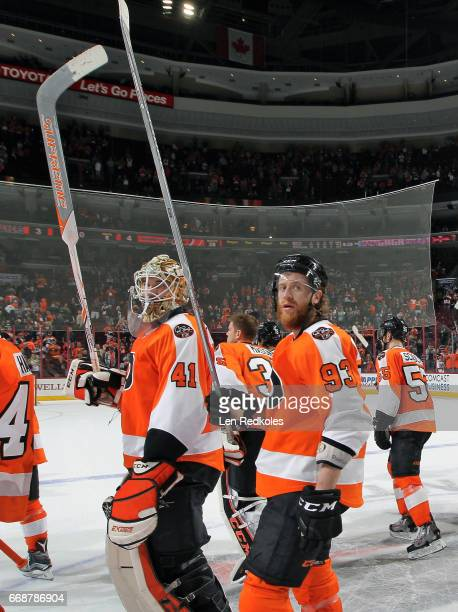 Anthony Stolarz and Jakub Voracek of the Philadelphia Flyers salute their fans in their final game of the 201617 NHL season after being defeated by...