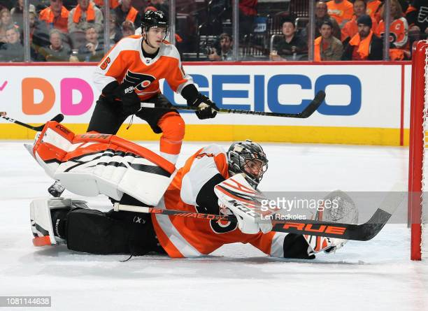 Anthony Stolarz and Travis Sanheim of the Philadelphia Flyers react to the play behind the net against the Columbus Blue Jackets on December 6 2018...