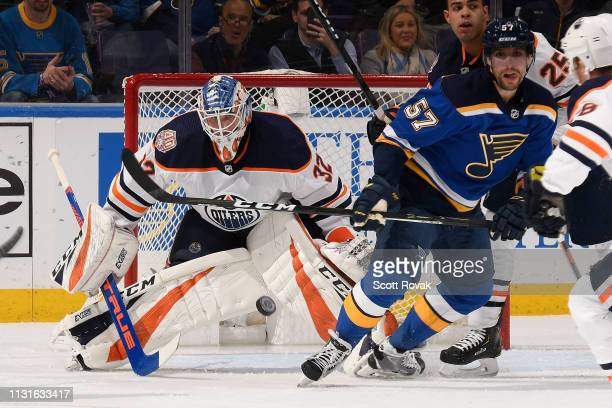 Anthony Stolarz of the Edmonton Oilers defends the net against David Perron of the St Louis Blues at Enterprise Center on March 19 2019 in St Louis...