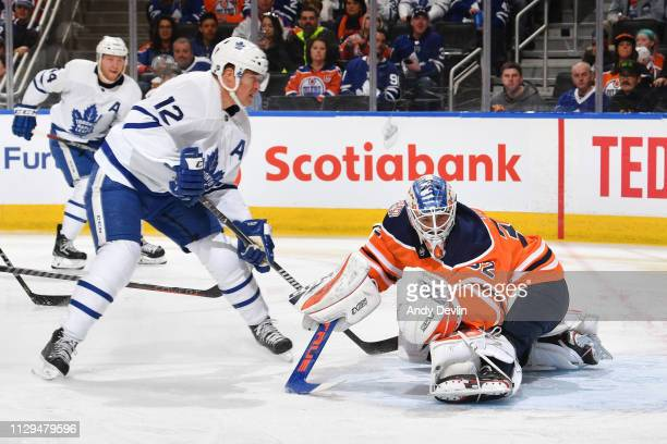 Anthony Stolarz of the Edmonton Oilers makes a save on a shot from Patrick Marleau of the Toronto Maple Leafs on March 9 2019 at Rogers Place in...