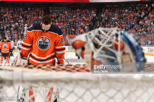 Anthony Stolarz of the Edmonton Oilers stands for the singing of the national anthem prior to the game against the Toronto Maple Leafs on March 9...