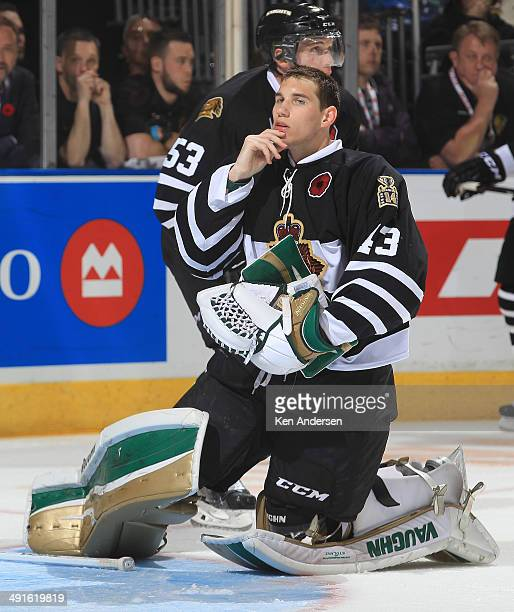 Anthony Stolarz of the London Knights checks his jaw after getting hit against the Val'Dor Foreurs in Game One of the 2014 Mastercard Memorial Cup at...