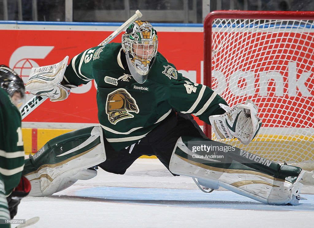 Anthony Stolarz #43 of the London Knights slides accross to get to a shot in a first round playoff game against the Saginaw Spirit on March 24, 2013 at the Budweiser Gardens in London, Ontario, Canada. The Knights defeated the Spirit 3-2 in double overtime to take a 2-0 series lead.