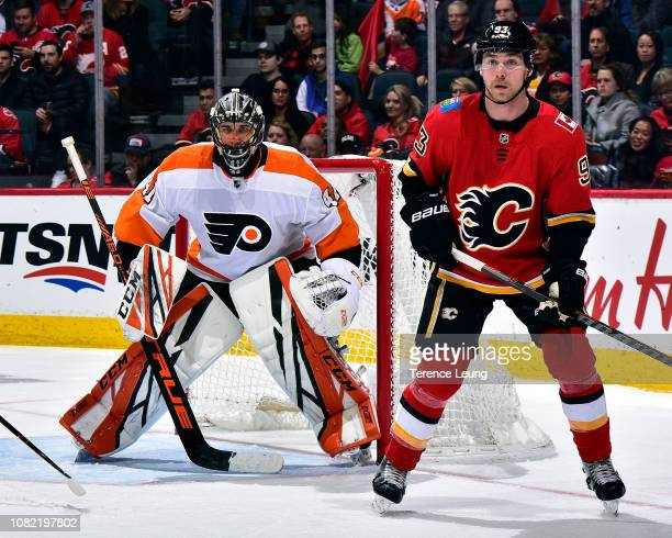 Anthony Stolarz of the Philadelphia Flyers and Sam Bennett of the Calgary Flames watch the play during an NHL game on December 12 2018 at the...
