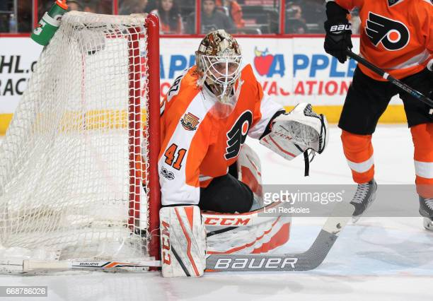 Anthony Stolarz of the Philadelphia Flyers follows the play along the far boards against the Carolina Hurricanes on April 9 2017 at the Wells Fargo...