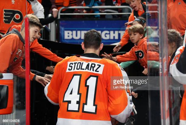 Anthony Stolarz of the Philadelphia Flyers greets his fans as he exits the ice surface after being named the First Star of the Game after defeating...