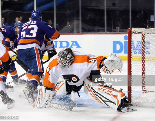 Anthony Stolarz of the Philadelphia Flyers guards the net against Casey Cizikas of the New York Islanders during the second period at the Barclays...