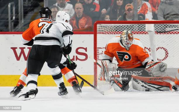 Anthony Stolarz of the Philadelphia Flyers makes a pad save as Claude Giroux defends against Austin Wagner of the Los Angeles Kings on February 7...