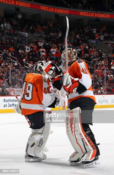 Anthony Stolarz of the Philadelphia Flyers motions toward emergency backup goaltender Eric Semborski as he skates to the bench during a stoppage in...