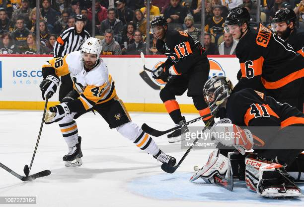 Anthony Stolarz of the Philadelphia Flyers protects the net against Zach AstonReese of the Pittsburgh Penguins at PPG Paints Arena on December 1 2018...