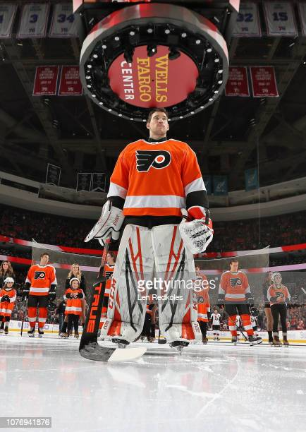 Anthony Stolarz of the Philadelphia Flyers stands on the ice during the National Anthem prior to the start of the game against the Ottawa Senators on...