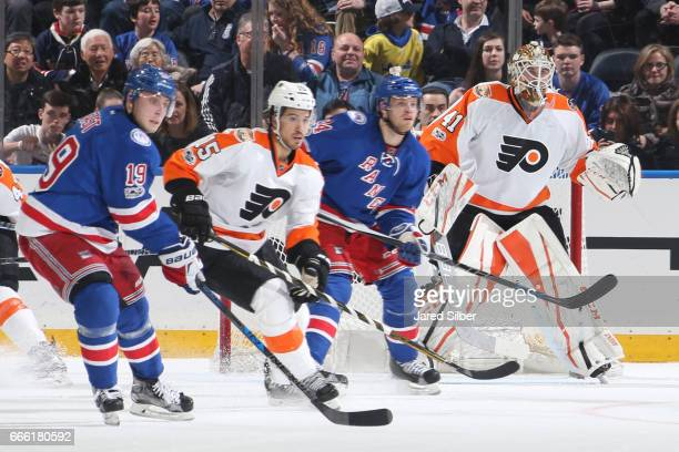 Anthony Stolarz of the Philadelphia Flyers tends the net as Michael Del Zotto defends against Oscar Lindberg and Jesper Fast of the New York Rangers...