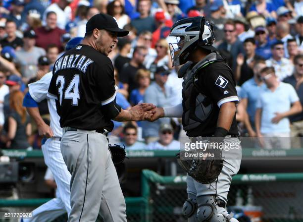 Anthony Swarzak of the Chicago White Sox and Omar Narvaez celebrate a win against the Chicago Cubs on July 24 2017 at Wrigley Field in Chicago...
