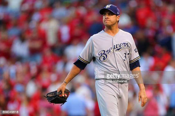 Anthony Swarzak of the Milwaukee Brewers leaves the field after giving up the gamewinning RBI double against the St Louis Cardinals in the eighth...