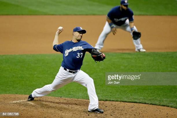 Anthony Swarzak of the Milwaukee Brewers pitches against the Washington Nationals during the eighth inning at Miller Park on August 31 2017 in...