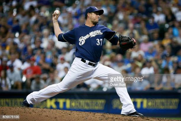 Anthony Swarzak of the Milwaukee Brewers pitches in the eighth inning against the St Louis Cardinals at Miller Park on August 3 2017 in Chicago...
