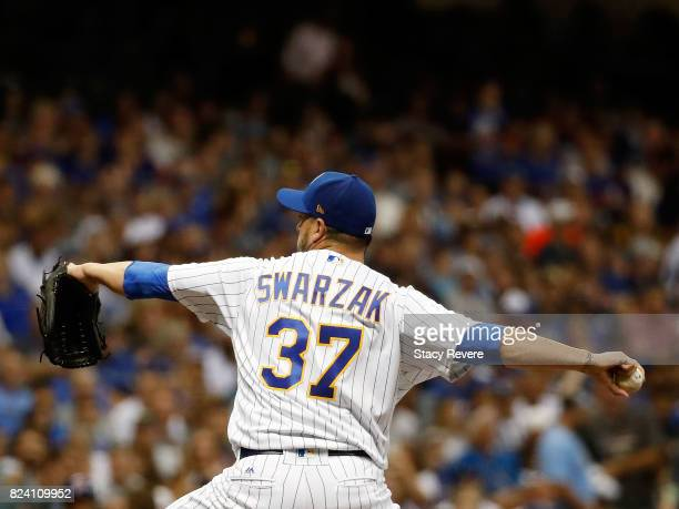 Anthony Swarzak of the Milwaukee Brewers throws a pitch during the eighth inning of a game against the Chicago Cubs at Miller Park on July 28 2017 in...