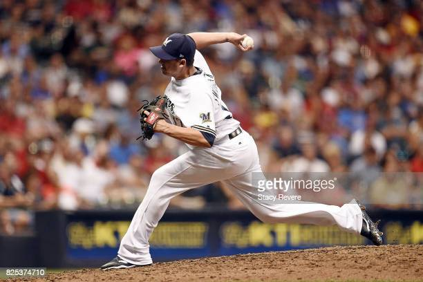 Anthony Swarzak of the Milwaukee Brewers throws a pitch during the eighth inning of a game against the St Louis Cardinals at Miller Park on August 1...