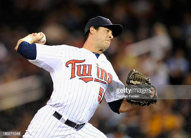 Anthony Swarzak of the Minnesota Twins delivers a pitch against the Oakland Athletics during the eighth inning of the game on September 10 2013 at...