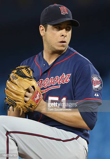 Anthony Swarzak of the Minnesota Twins delivers a pitch during MLB game action against the Toronto Blue Jays on October 2 2012 at Rogers Centre in...