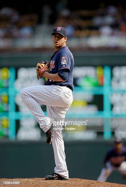 Anthony Swarzak of the Minnesota Twins delivers a pitch during the game against the Chicago White Sox on September 16 2012 at Target Field in...