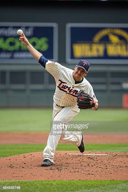 Anthony Swarzak of the Minnesota Twins pitches against the Cleveland Indians on July 23 2014 at Target Field in Minneapolis Minnesota The Twins...
