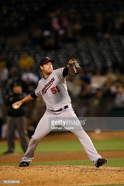Anthony Swarzak of the Minnesota Twins pitches during the game against the Oakland Athletics at Oco Coliseum on September 19 2013 in Oakland...