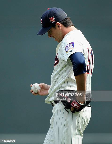 Anthony Swarzak of the Minnesota Twins reacts during the tenth inning of the game against the San Diego Padres on August 6 2014 at Target Field in...