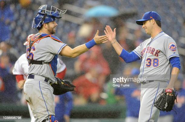 Anthony Swarzak of the New York Mets celebrates with Kevin Plawecki after a 86 victory against the Washington Nationals at Nationals Park on...