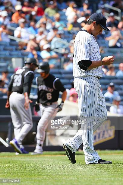 Anthony Swarzak of the New York Yankees reacts after giving up a two-run home run to Ryan Raburn of the Colorado Rockies in the fifth inning at...
