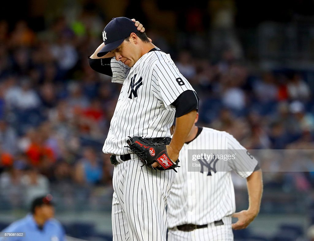 Anthony Swarzak #43 of the New York Yankees reacts in the 12 inning against the San Francisco Giants on July 23, 2016 at Yankee Stadium in the Bronx borough of New York City.