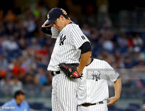 Anthony Swarzak of the New York Yankees reacts in the 12 inning against the San Francisco Giants on July 23 2016 at Yankee Stadium in the Bronx...