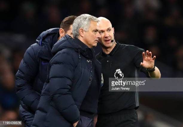 Anthony Taylor explains reported racism to Jose Mourinho Manager of Tottenham Hotspur during the Premier League match between Tottenham Hotspur and...