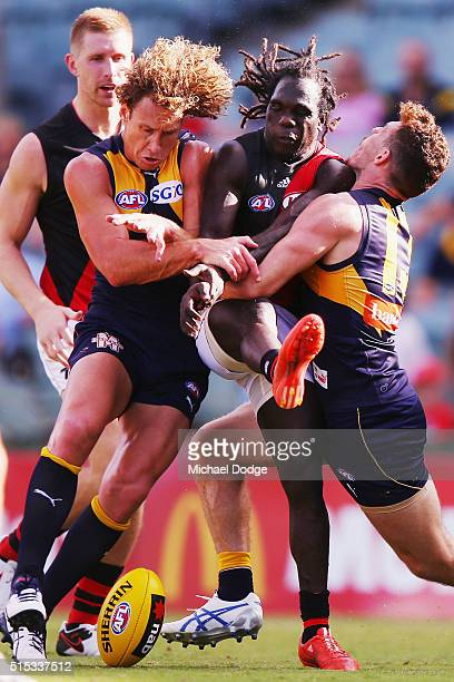 Anthony Tipungwuti of the Bombers is tackled by Matt Priddis of the Eagles and Luke Shuey during the NAB Challenge AFL match between the West Coast...