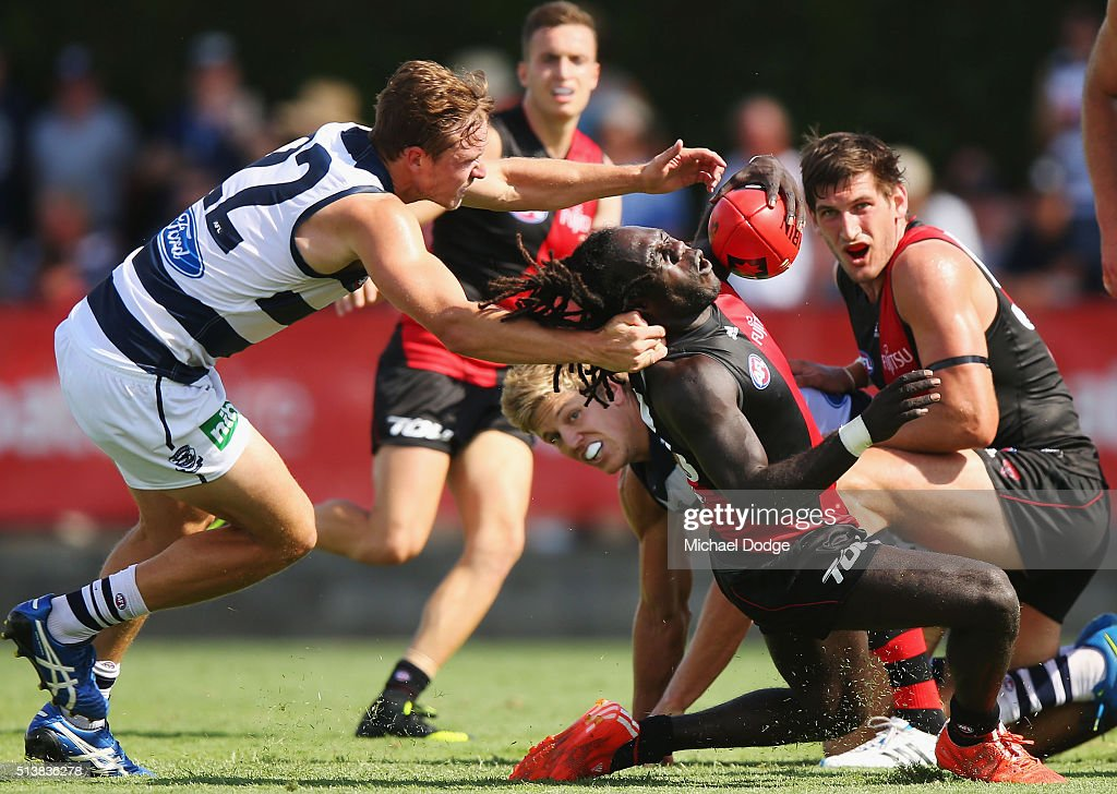 Anthony Tipungwuti of the Bombers is tackled high by Mitch Duncan of the Cats during the 2016 AFL NAB Challenge match between the Essendon Bombers and the Geelong Cats at Deakin Resserve on March 5, 2016 in Shepparton, Australia.