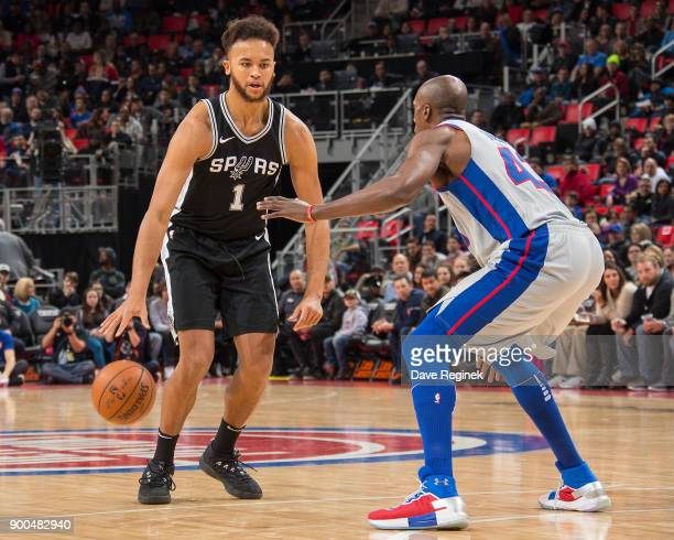 Anthony Tolliver of the Detroit Pistons defends against Kyle Anderson of the San Antonio Spurs in the first half of NBA game at Little Caesars Arena...