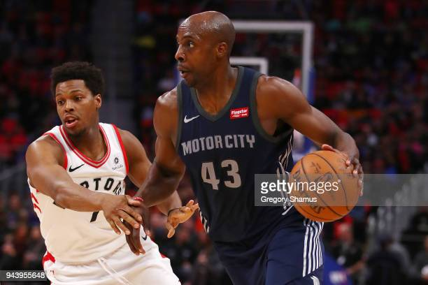 Anthony Tolliver of the Detroit Pistons drives around Kyle Lowry of the Toronto Raptors during the first half at Little Caesars Arena on April 9 2018...