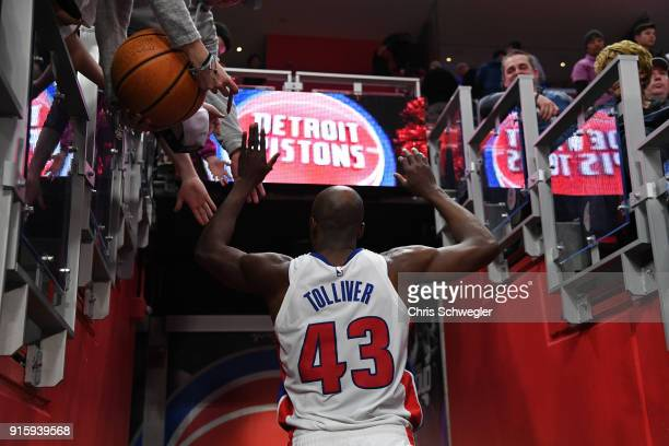 Anthony Tolliver of the Detroit Pistons high fives fans after the game against the Portland Trail Blazers on February 5 2018 at Little Caesars Arena...