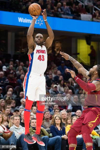 Anthony Tolliver of the Detroit Pistons shoots over Jae Crowder of the Cleveland Cavaliers during the first half at Quicken Loans Arena on January 28...