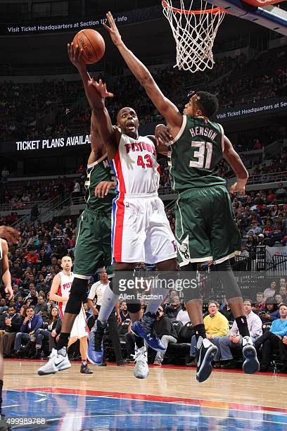 Anthony Tolliver of the Detroit Pistons shoots the ball against John Henson of the Milwaukee Bucks on December 4 2015 at The Palace of Auburn Hills...